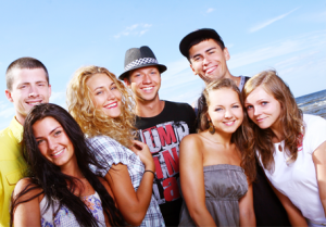 group of young adults on beach smiling